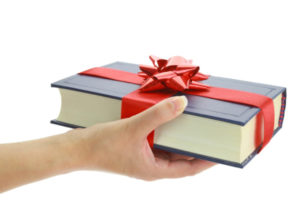 Woman's hand holding a book for gift